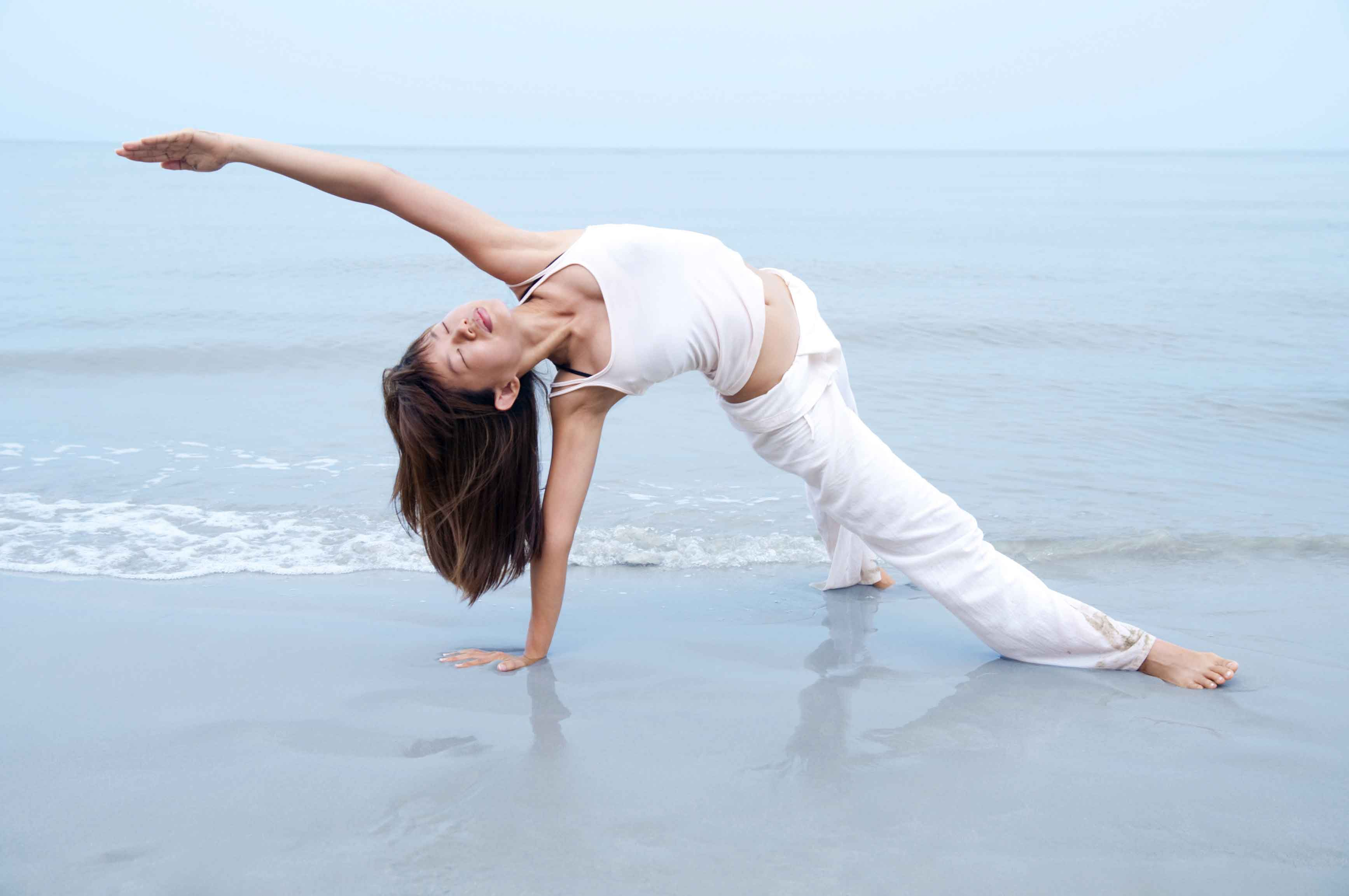 yoga on the beach - wild thing