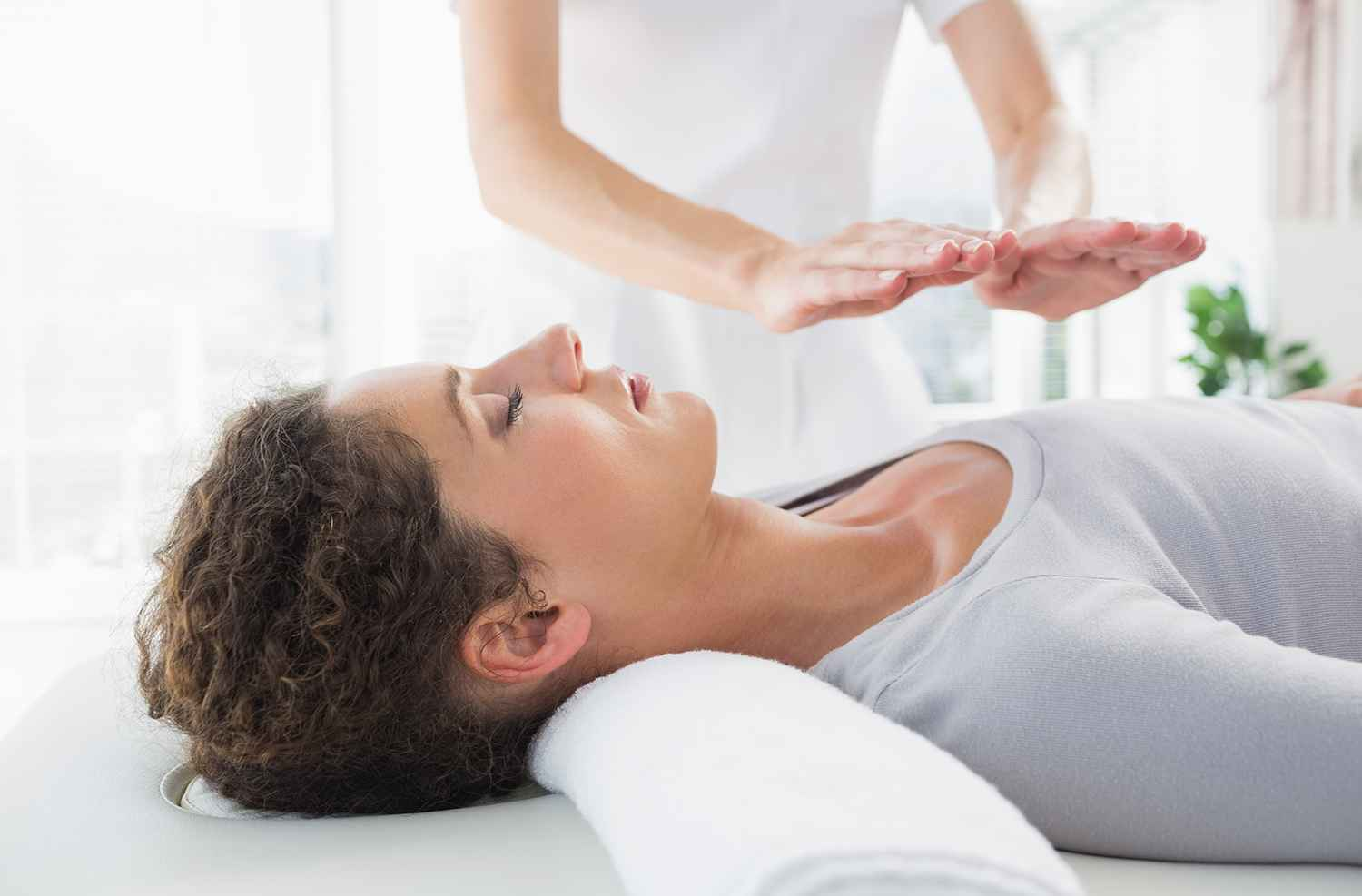woman lying down having a reiki treatment
