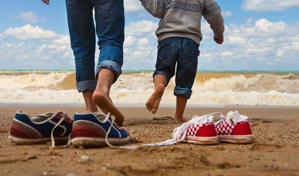 dreamstime_xl_father_son_walk_on_beach