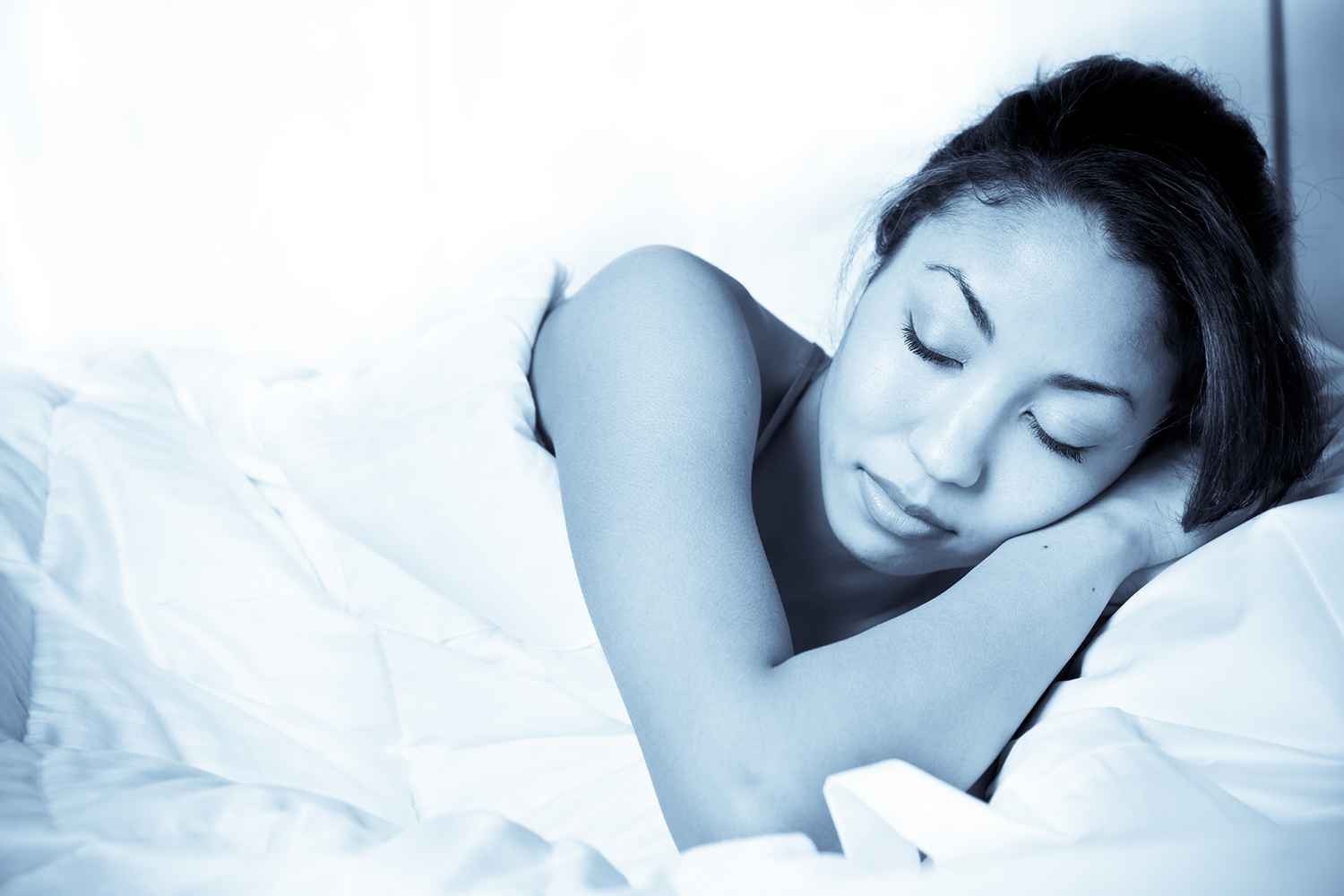 woman in bed sleeping peacefully