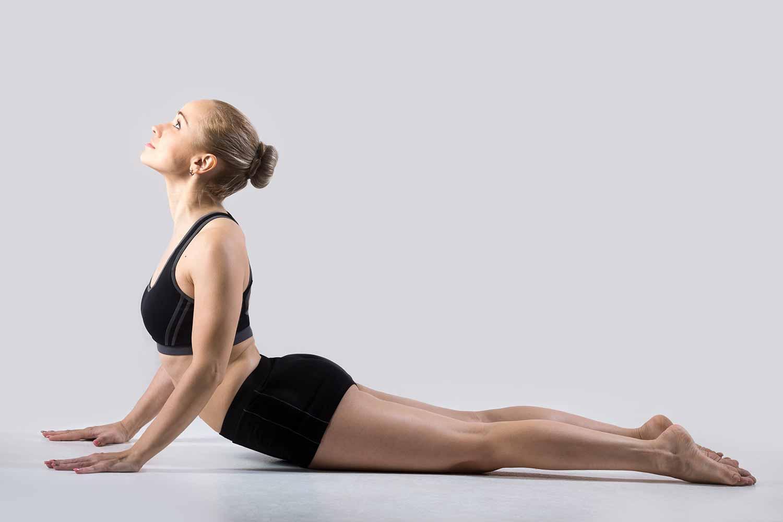 girl doing full cobra pose (yoga)