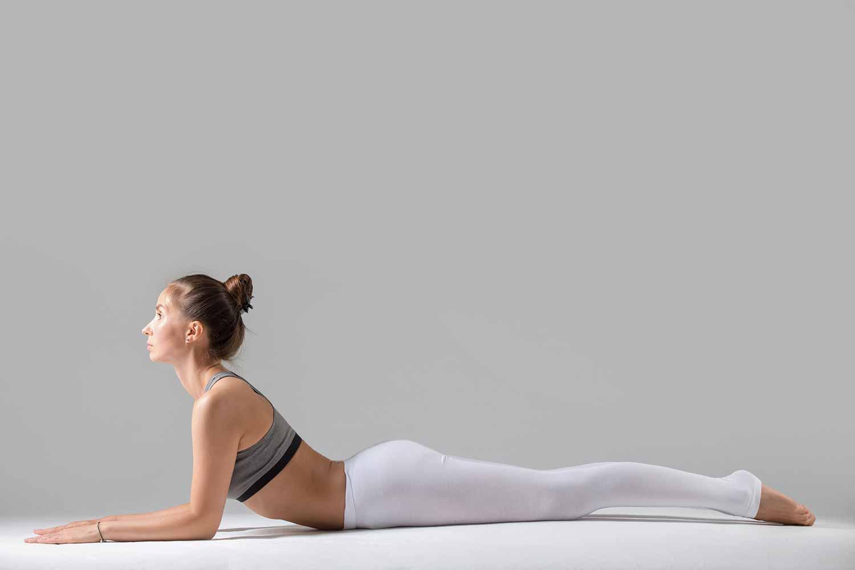 girl doing sphinx pose (yoga)