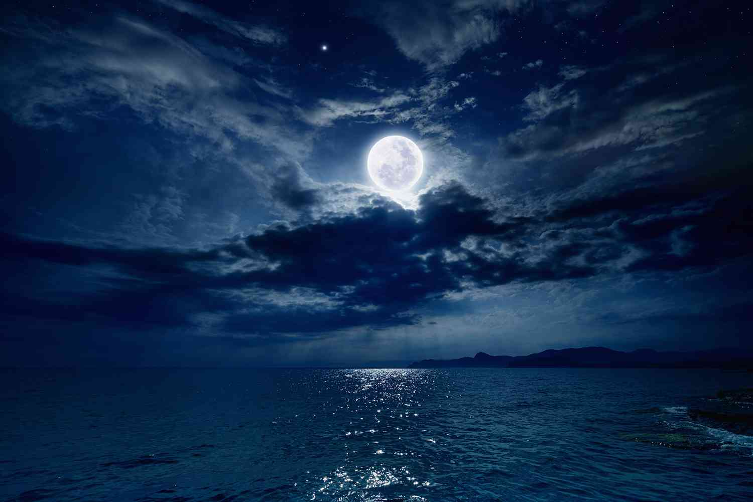 full moon over the sea at night