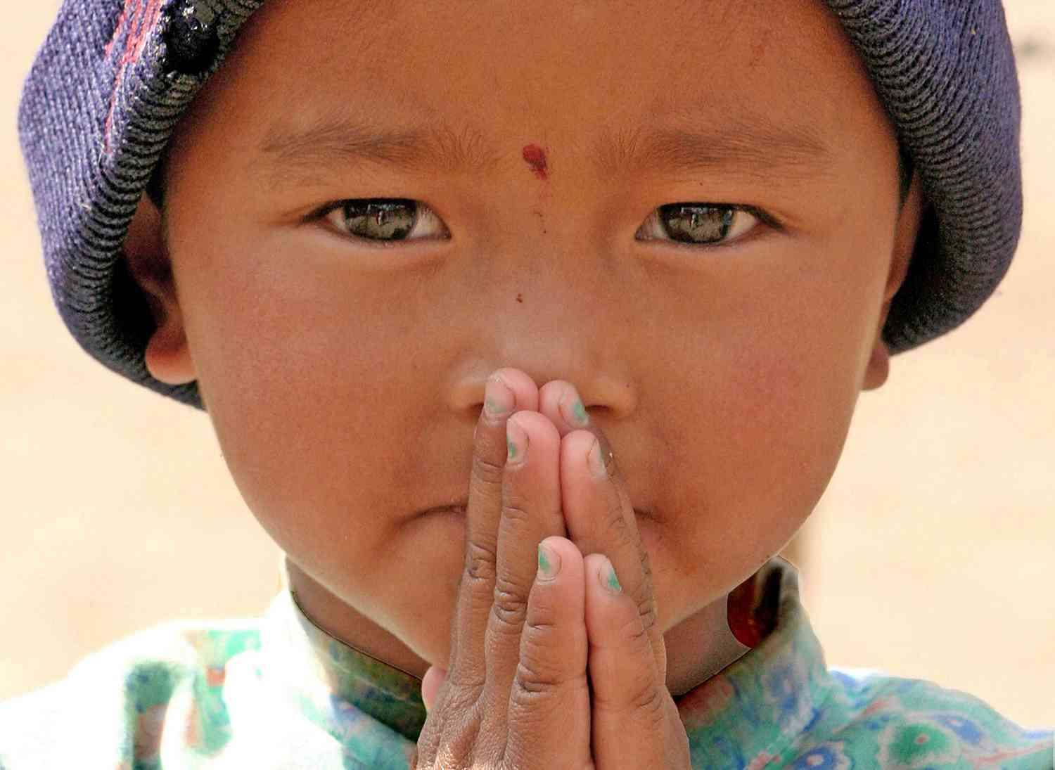 nepal boy doing anjali mudra and namaste