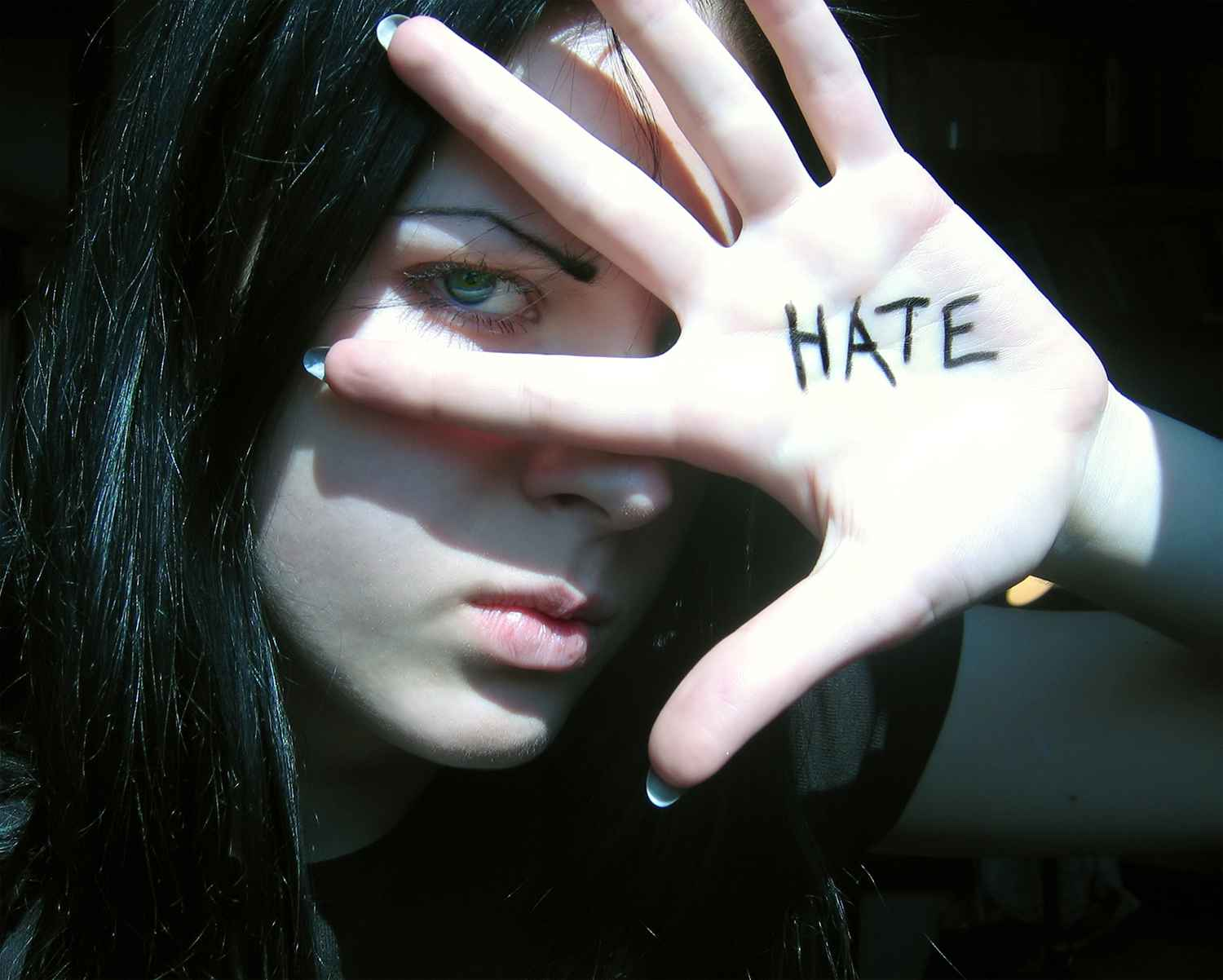 woman with hate written on her hand