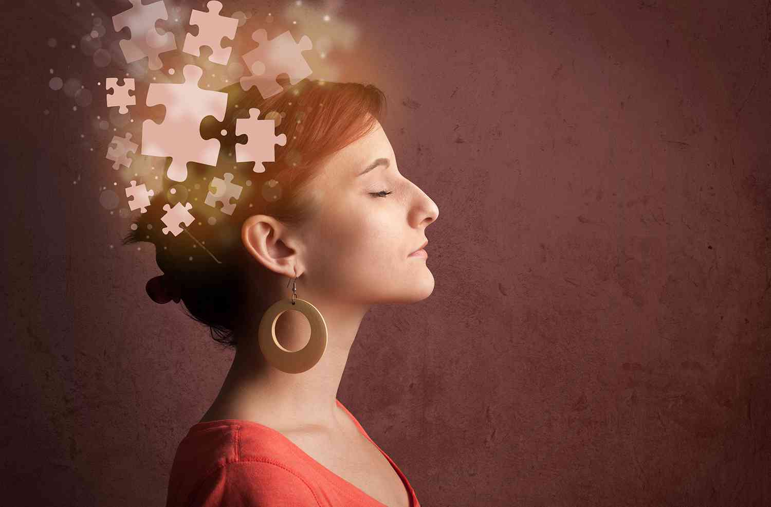 person thinking glowing puzzle mind