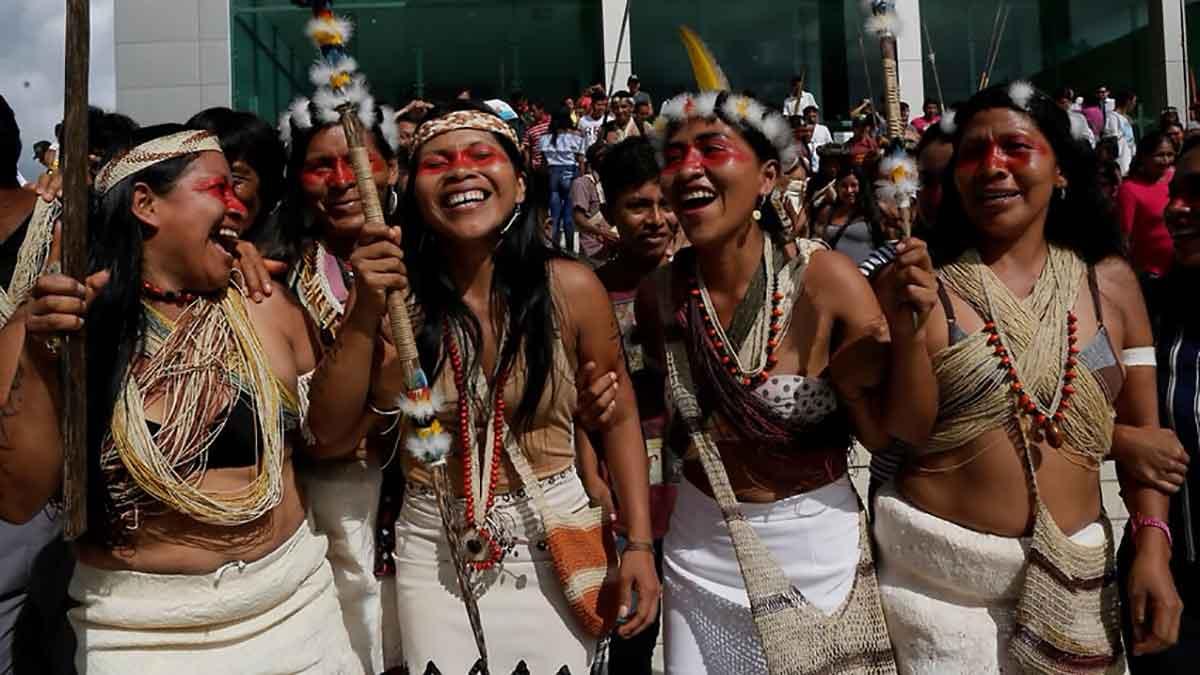 Waoranis and leader Nemonte Nenquimo celebrate
